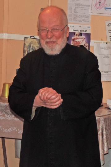 Fr White arrives for his 'surprise' party.