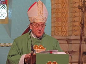 Archbishop Kondrusuewicz preaches at the Sunday morning Mass