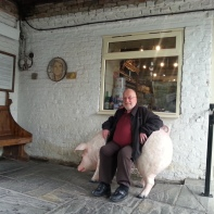 Fr. David sitting on a pig-chair.