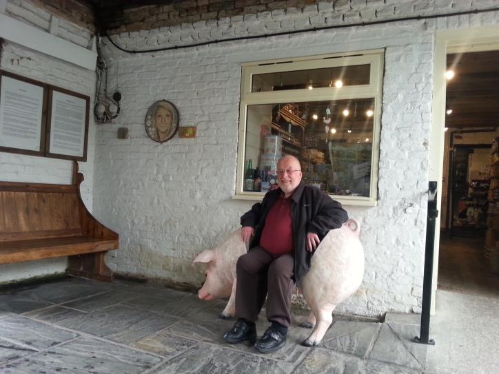 Fr. David sitting on a pig-chair.