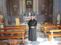 Fr Leo Parish Priest for the Island of Lesbos Total size of his church six benches and two chairs.