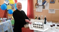 Fr. David cutting his cake.