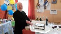 Fr. David cutting his cake.